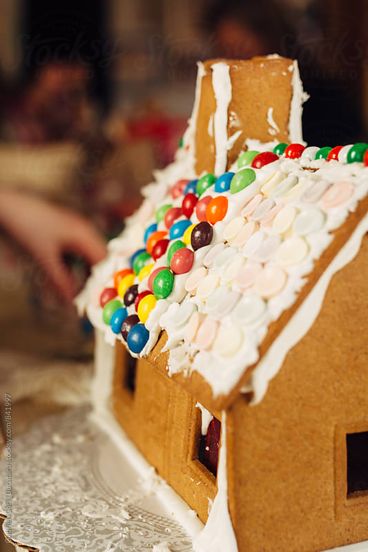 Gingerbread house with frosting by Gabriel (Gabi) Bucataru for Stocksy United