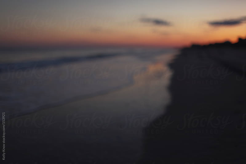 blurred view of the ocean at sunset by Kelly Knox for Stocksy United