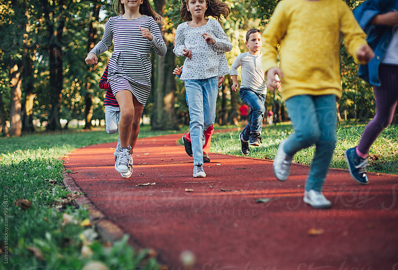 Kids Running Outdoors by Lumina for Stocksy United
