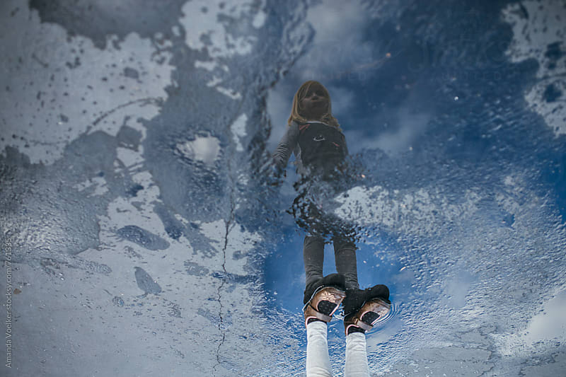 Puddle Portrait of  little Girl Standing by Amanda Voelker for Stocksy United