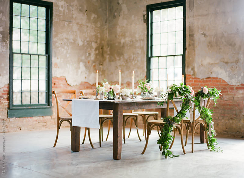 Elegant Loft Dinner Table by Marta Locklear for Stocksy United