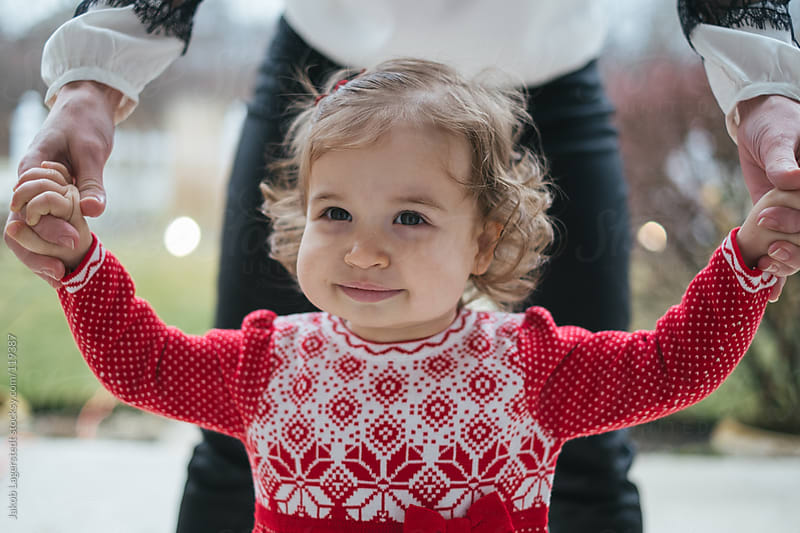 Toddler in a christmas sweater by Jakob for Stocksy United