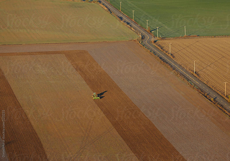 Aerial view of farmland and road by Daniel Hurst for Stocksy United