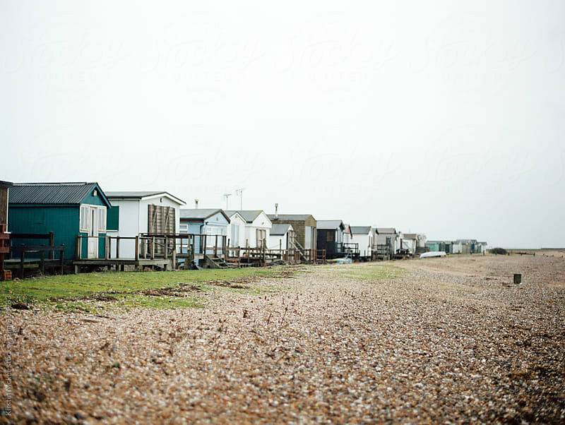 Row of beach huts. by Kirstin Mckee for Stocksy United