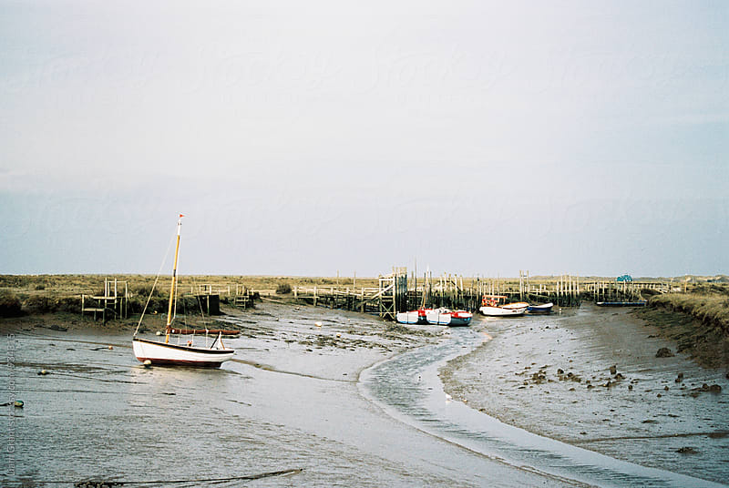 Boats at low tide. Morston Quay, Norfolk, UK. by Liam Grant for Stocksy United