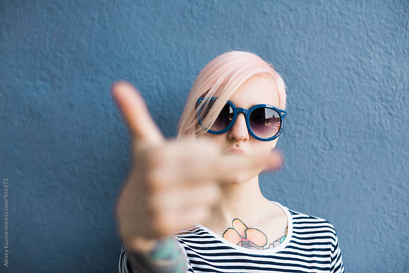 cool young woman showing middle finger by Vesna for Stocksy United