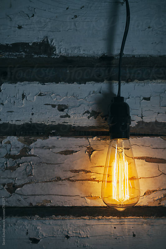 Light: Old Light Bulb Glows With Lots Of Copyspace by Sean Locke for Stocksy United