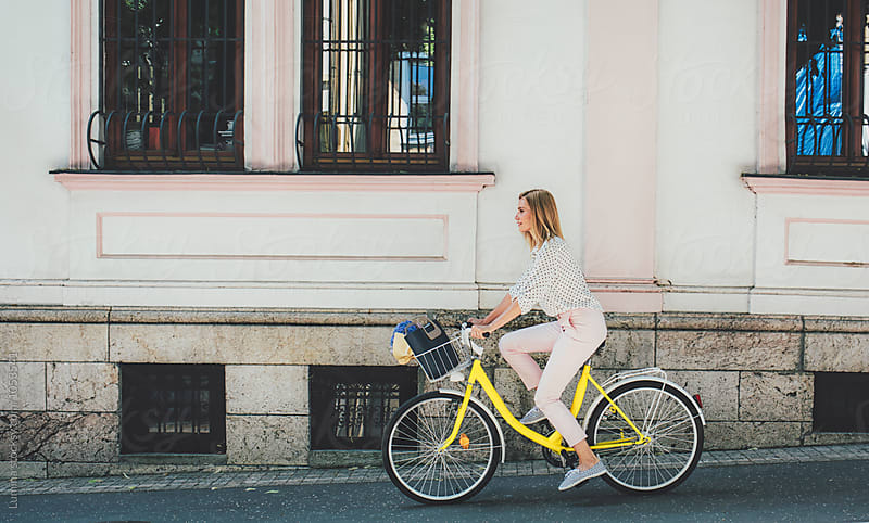Woman Riding a Bicycle by Lumina for Stocksy United