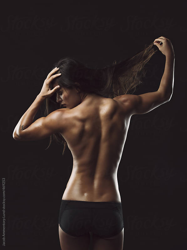 Fitness female with muscular body by Jacob Ammentorp Lund for Stocksy United