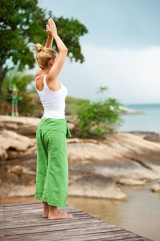 Woman Practising Yoga by the Ocean by Mosuno for Stocksy United