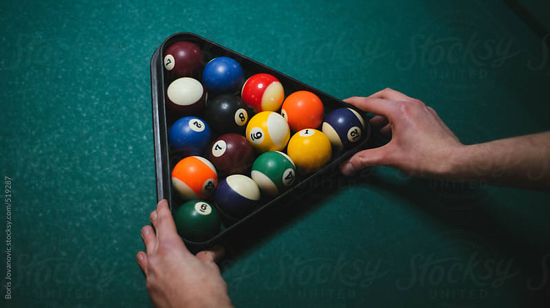Man setting up the balls for snooker by Boris Jovanovic for Stocksy United