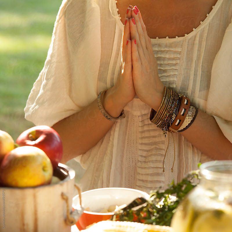 Hands of a Woman Praying Before Eating by Lumina for Stocksy United