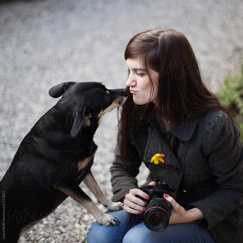 Brunettes love dogs by Laura Stolfi for Stocksy United