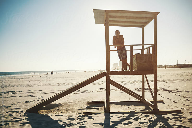 Young man posing on the lifeguard post  by Borislav Zhuykov for Stocksy United
