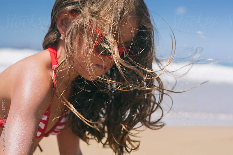 Wind blowing in to child's hair by Dejan Ristovski for Stocksy United