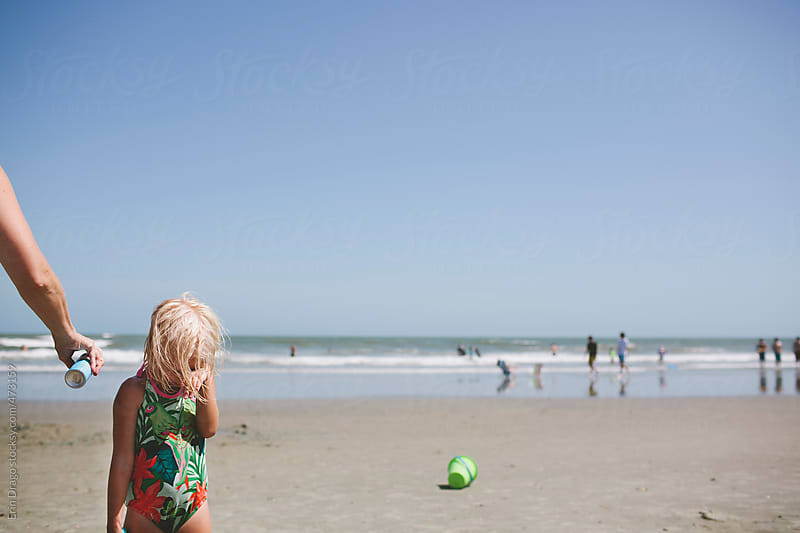 girl on beach by Erin Drago for Stocksy United