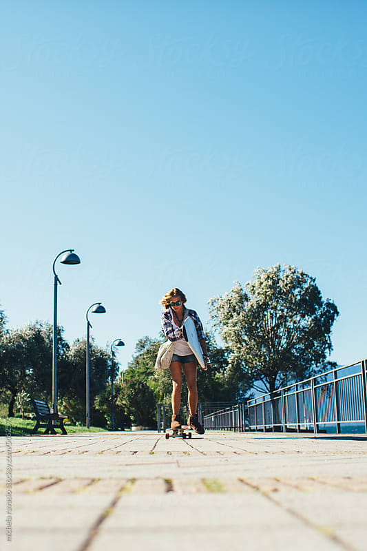Girl going with longboard, holding her surfboard by michela ravasio for Stocksy United