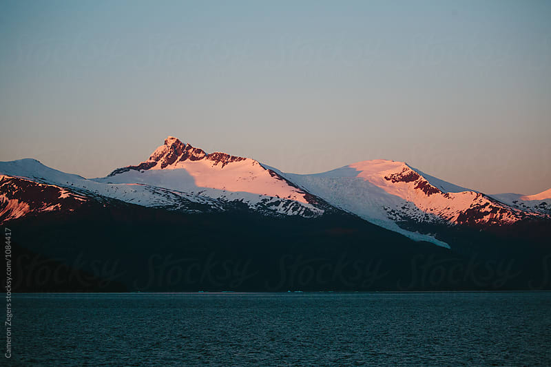 evening light on Alaska mountains by Cameron Zegers for Stocksy United