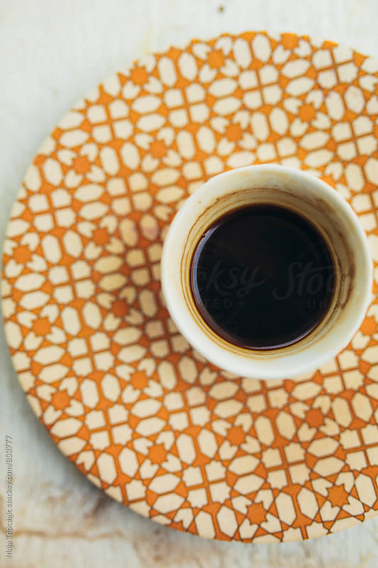 Black morning coffee on a plate by Maja Topcagic for Stocksy United
