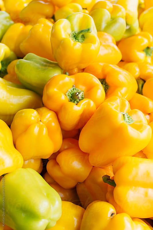 Yellow bell peppers by Kristin Duvall for Stocksy United