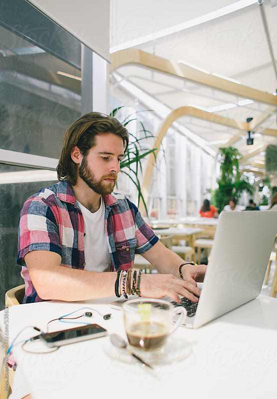 Coworking space - young designer working by Jovo Jovanovic for Stocksy United
