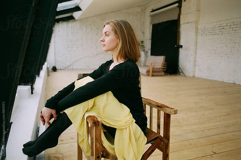 Woman sitting in a loft by Lyuba Burakova for Stocksy United