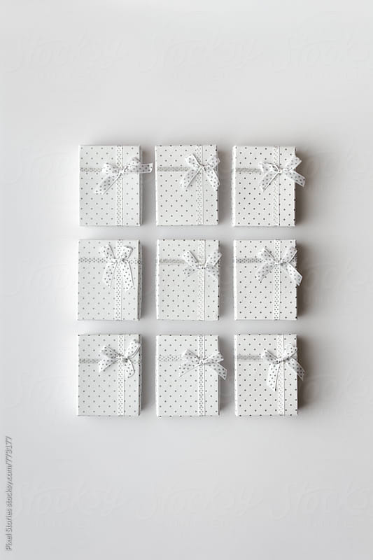 White gifts on white by Pixel Stories for Stocksy United