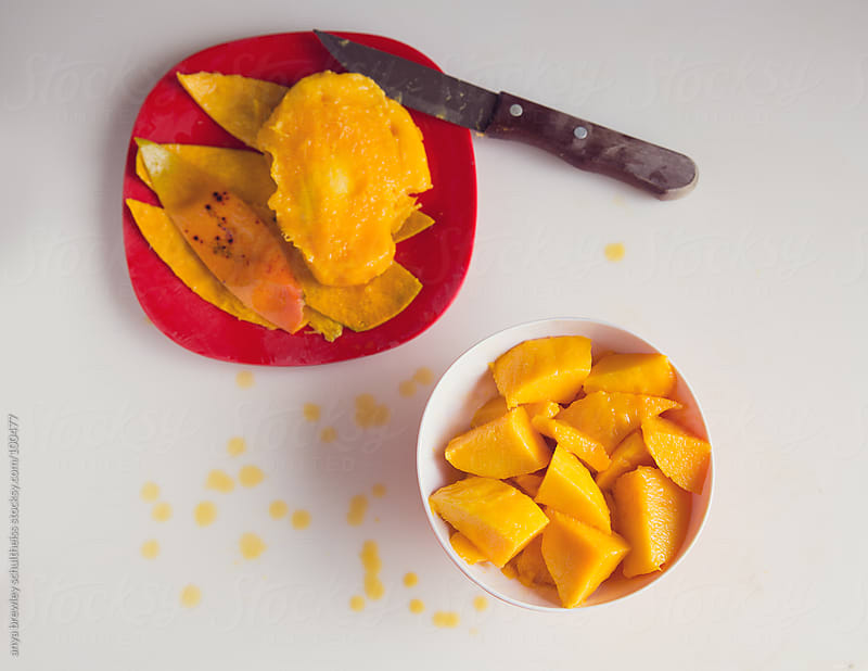 Ripe mango peeled and cubed by anya brewley schultheiss for Stocksy United