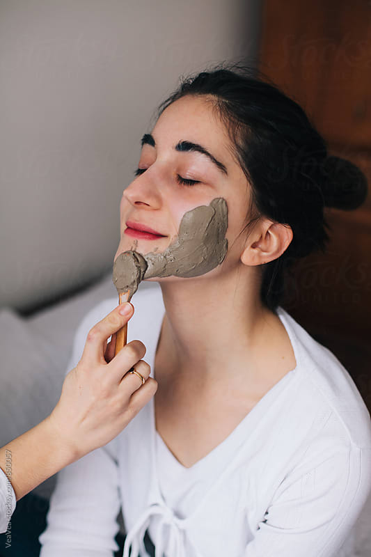 Woman with home made facial mask indoor by VeaVea for Stocksy United