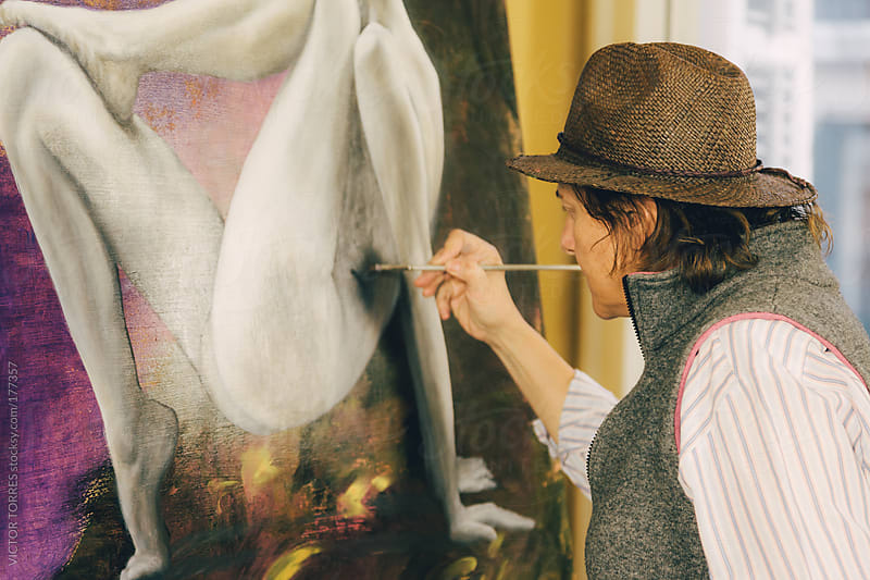 Woman Painting in a Workshop by VICTOR TORRES for Stocksy United