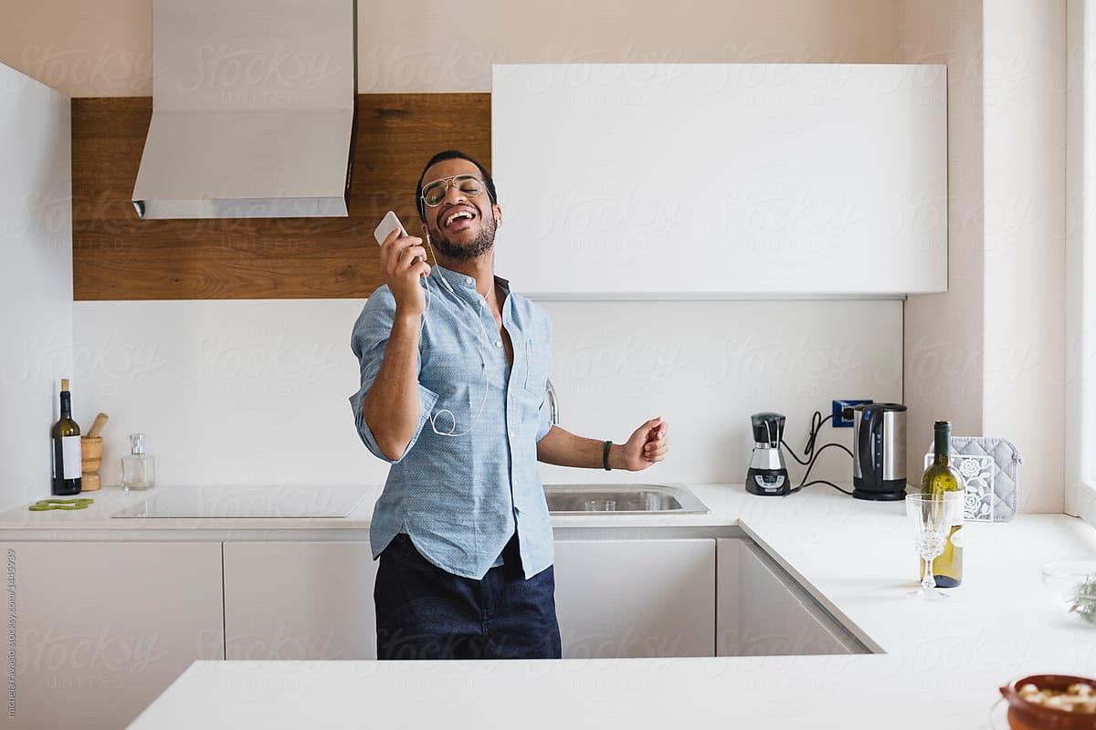 Man Singing Alone In The Kitchen By Michela Ravasio