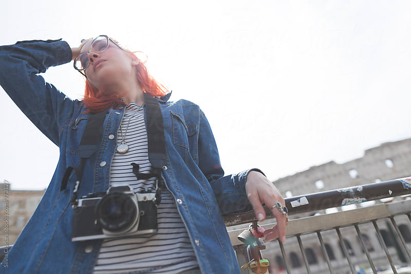 Tourist woman near the Coliseum of Rome by Silvia Cipriani for Stocksy United