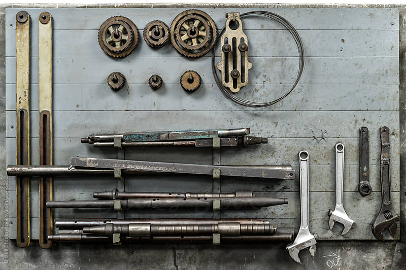Old metal tools hanging by Bisual Studio for Stocksy United