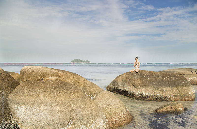 Woman Meditating in silence on the Rock by Mosuno for Stocksy United