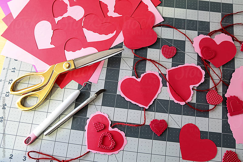 Diy project for paper heart garland by Sandra Cunningham for Stocksy United