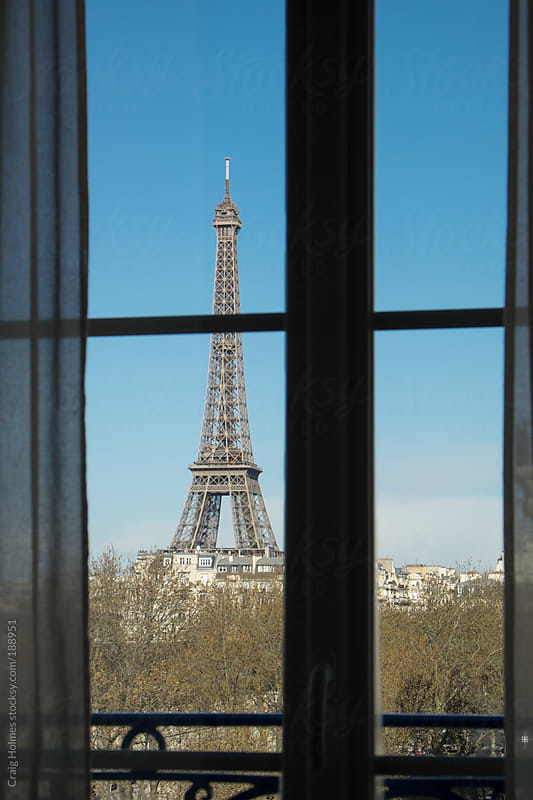 The Eiffel Tower, Paris, France, viewed through a window. by Craig Holmes for Stocksy United