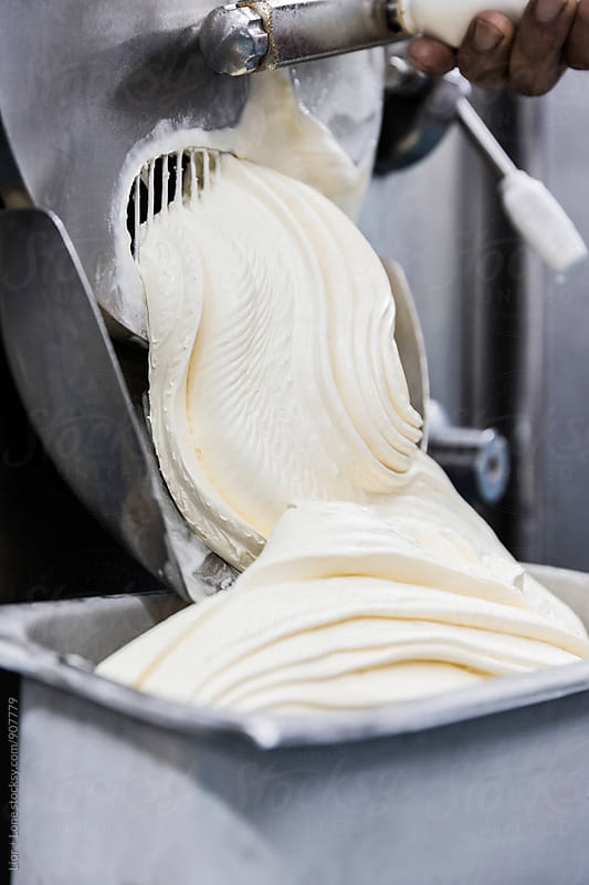 Thick vanilla ice cream following out of industrial machine by Lior + Lone for Stocksy United