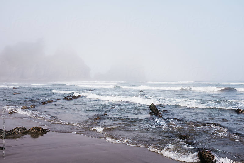 waves crashing on rock formations  by Jesse Morrow for Stocksy United