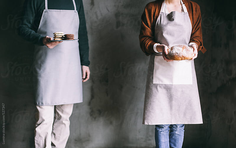 Couple Holding Bakery Products by Lumina for Stocksy United