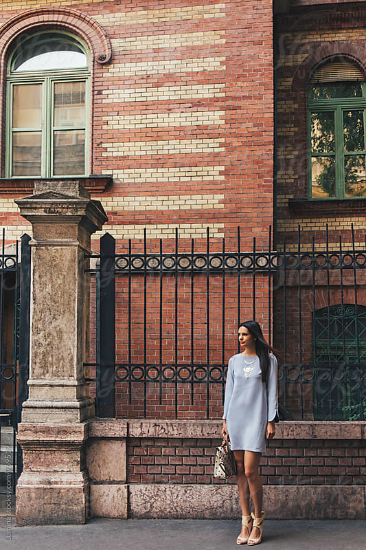 Elegant Woman in a Blue Dress on the Street by Lumina for Stocksy United