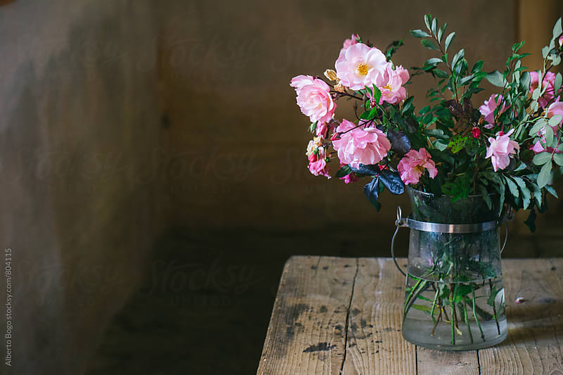 Bouquet of Flowers on Wooden Table by Alberto Bogo for Stocksy United