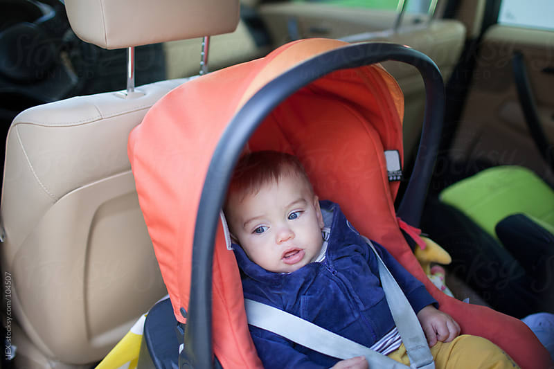 Baby Into Car with Safety Belt by HEX. for Stocksy United