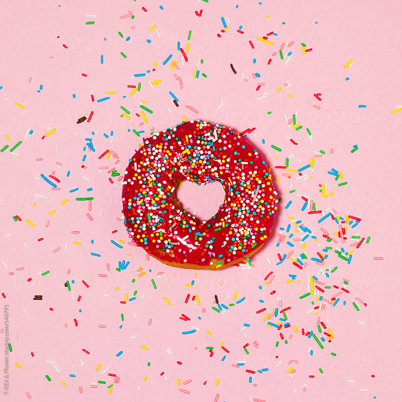A donut with heart-shaped hole by T-REX & Flower for Stocksy United