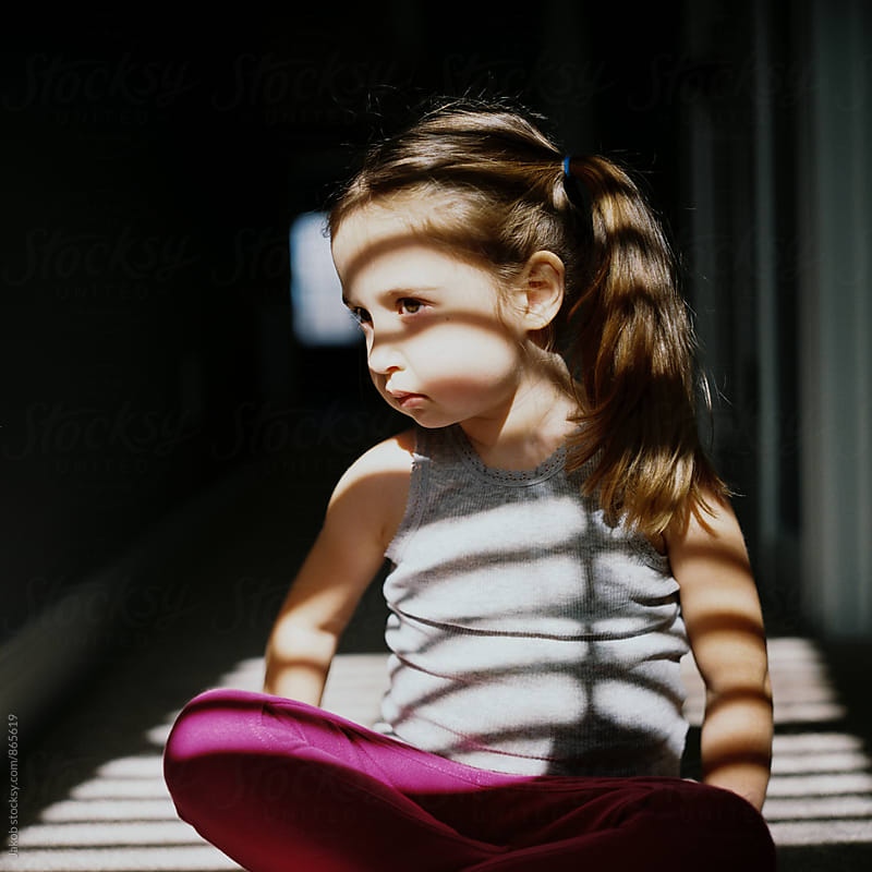 Portrait of a beautiful young girl with shadows of light by Jakob for Stocksy United