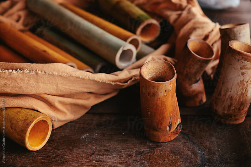 still life with bamboo poles  by Alexander Grabchilev for Stocksy United