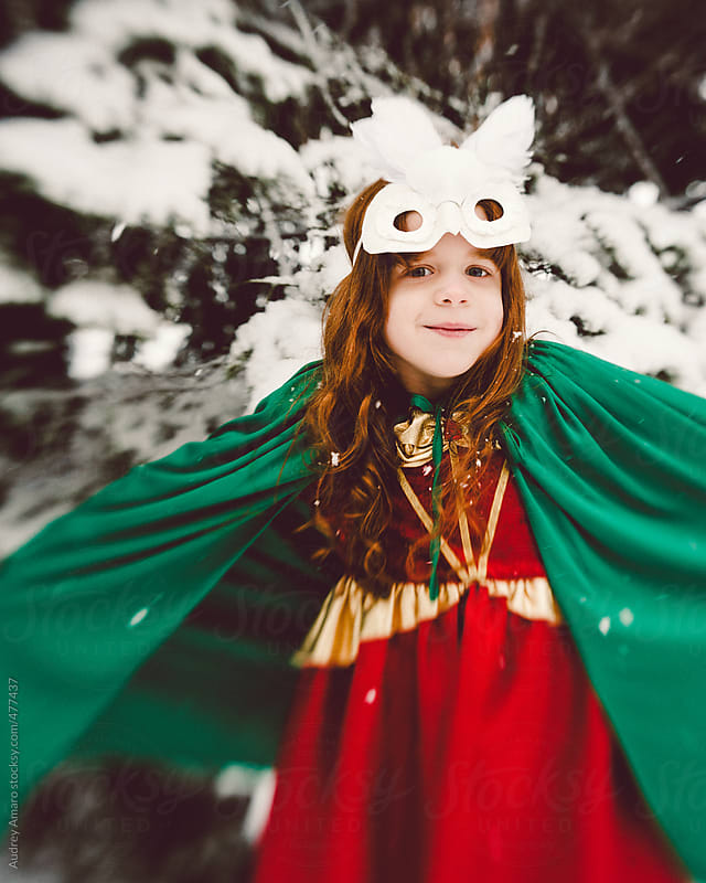 Whimsical girl plays in the snow by Audrey Amaro for Stocksy United