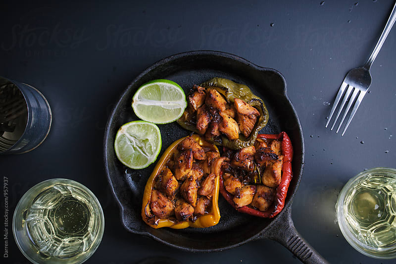 Chipotle chicken: Chipotle chicken stuffed bell peppers. by Darren Muir for Stocksy United