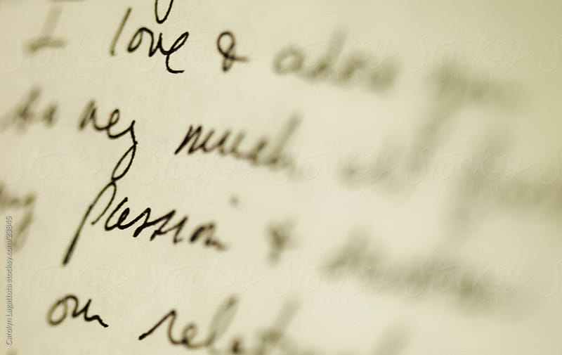 Cursive writing - words of love in a handwritten love note by Carolyn Lagattuta for Stocksy United