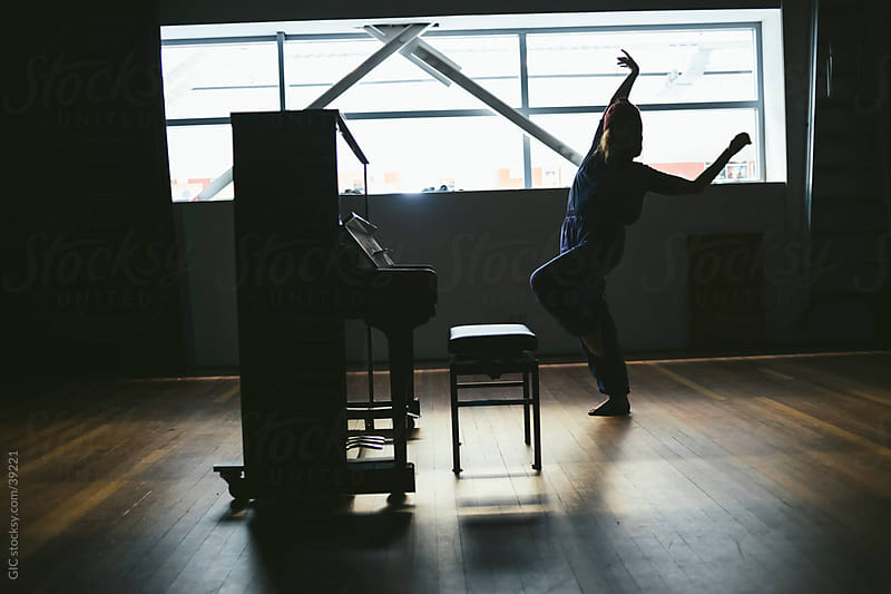 Dancer girl performing against a piano by Simone Becchetti for Stocksy United