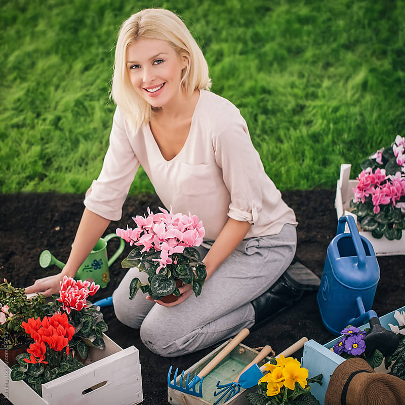 Smiling Woman Gardening by Lumina for Stocksy United